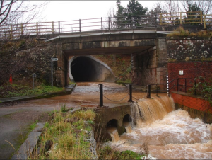 Water up to 30cm deep regularly floods the underpass at Brandsmill