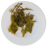soggy green leaves on a plate